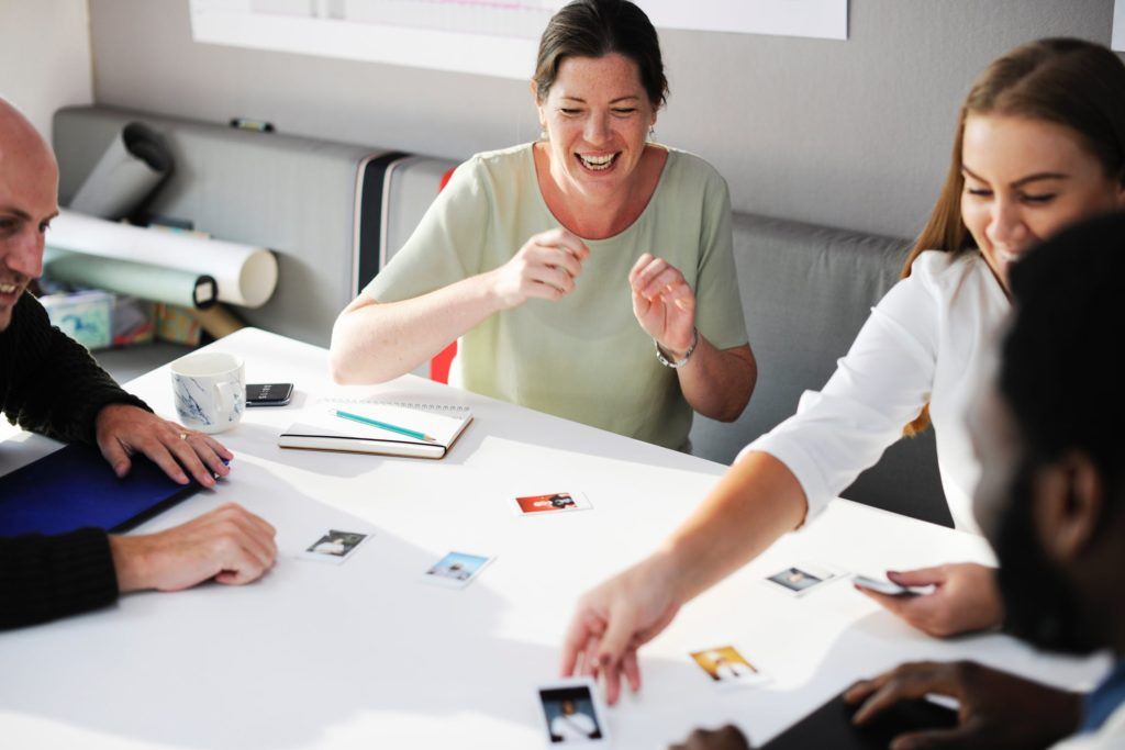 organizational culture people playing uno laughing
