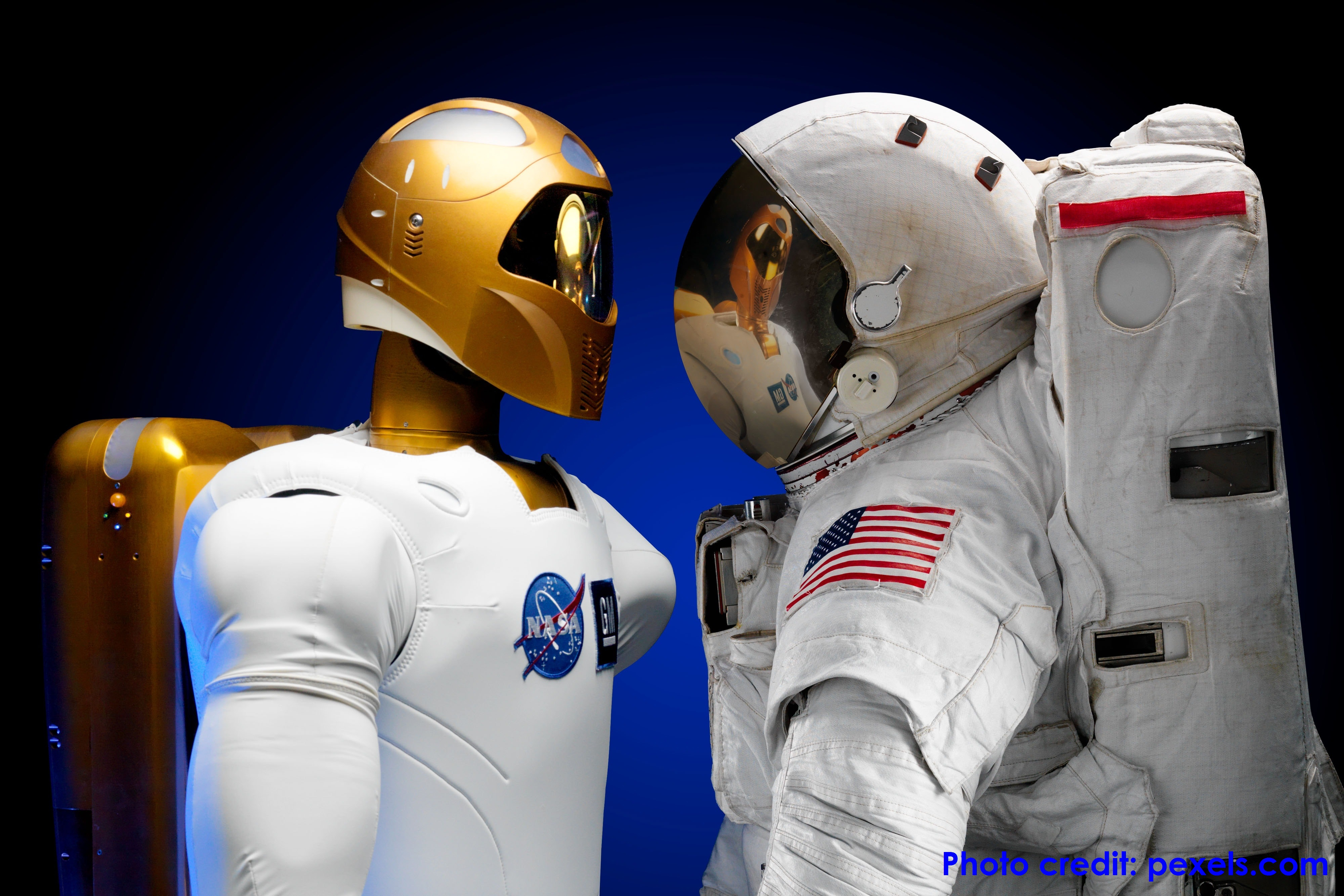Robot and astronaut standing together
